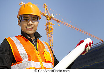 Portraite site manager with safety vest under construction