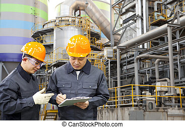 engineer oil refinery - two engineer discussing a new...