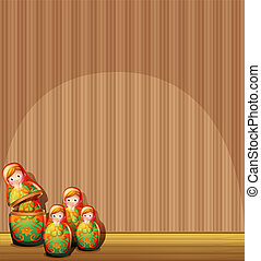 The four Russian dolls in front of an empty wall -...