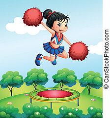 A cheerleader above a trampoline