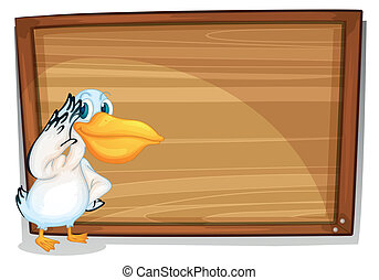A bird beside a wooden board