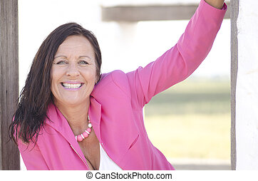 Happy sexy mature woman in pink outdoor