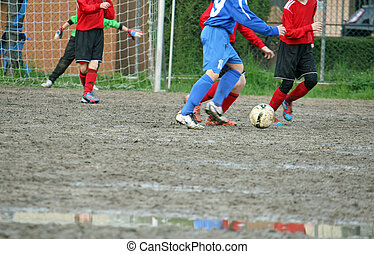 children players during a football match in a playing field...