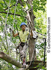 Preteen girl at the obstacle course - A preteen girl is...