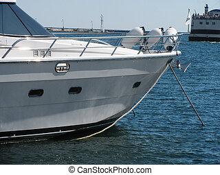 speed boat in seaport - bowsprit of luxury speed boat in...