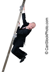 scared ladder of business - businessman hanging on to ladder...