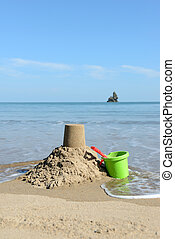 bucket and spade - beautiful sunny day at the beach with...