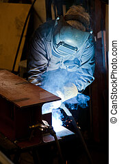Welding worker in factory - Industrial welder in working...