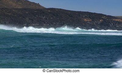 huge cyan wave spray vulcan beach