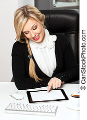 businesswoman in the office with tablet