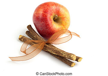 apple and licorice  isolated on white background