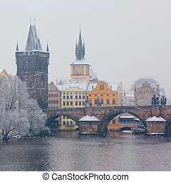 snow Charles bridge in Prague - morning view on snow Charles...
