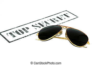 Top secret stamp and sunglasses on white background