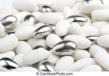 close up of white and silver sugared almonds