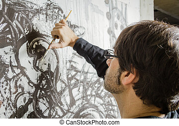 Painter artist working on a oil canvas - Painter artist...