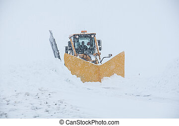 A powerful machine for a big job - The snowplow taking a...