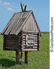 The hut of Baba Yaga - Log hut of the Baba-yaga A decorative...