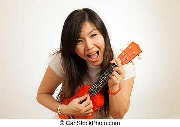Aian woman enjoy her Ukulele