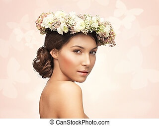 woman wearing wreath of flowers - picture of young woman...
