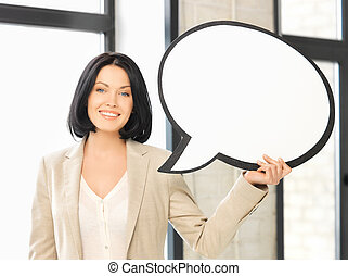 smiling businesswoman with blank text bubble - picture of...