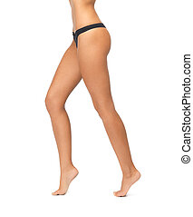 female legs in black bikini panties - picture of female legs...