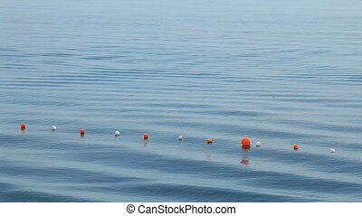 Watery waste - Floating beacon on the sea surface