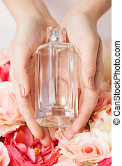 womans hands showing perfume - close up of womans hands...