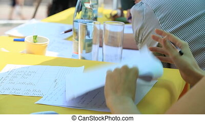 Making notes - Woman making additional notes to a document