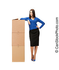 businesswoman with big carton boxes - picture of attractive...
