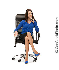 businesswoman sitting in chair - picture of young...