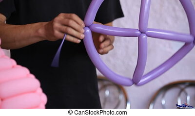 Party decorations - Man preparing balloon decorations for a...