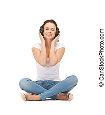 woman with headphones - picture of happy and smiling woman...