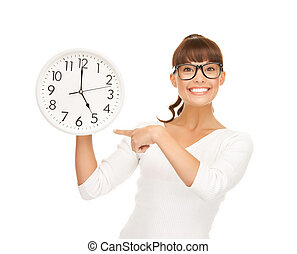 businesswoman pointing her finger at wall clock - attractive...