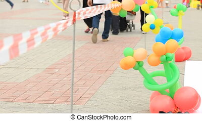 Balloon figures - Balloons in shape of flowers exposed on a...