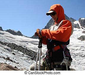 mountain climber - young mountain climber prepairing to go...