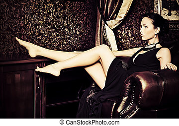 nostalgic mood - Beautiful young woman in a luxurious...