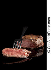 beef steak medium rare - delicious beef steak with fork on...