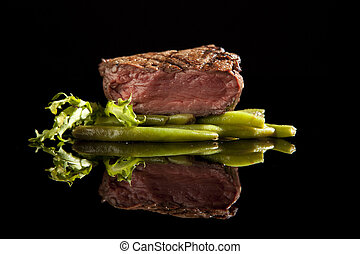 beef steak medium rare on black background - beef steak with...