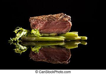 beef steak medium rare on black background - beef steak with...