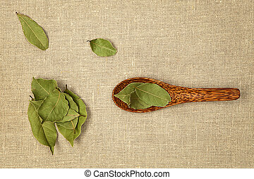 Bay leaves. - Bay leaves on wooden spoon on natural...