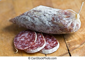 salami pieces on wood table