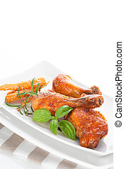 Delicious poultry legs. - Chicken legs with fresh basil,...
