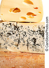Various cheese background. - Huge blocks of various cheese....