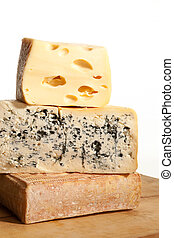 Delicious cheese background. - Three huge various cheese...