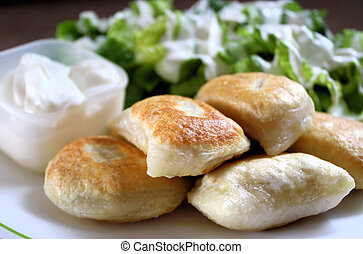 Perogies - Fried perogies stuffed with cheese and potato....