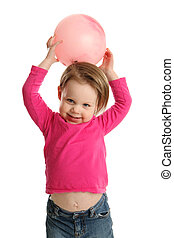 Young girl holding ball showing navel - Little girl holding...