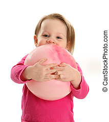 Little girl hugging a ball - Young toddler girl playing with...