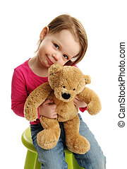 Sweet girl holding a teddy bear - Young girl holding a teddy...