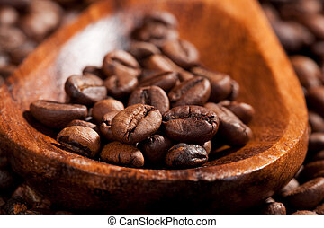 Coffee - Coffee beans on wooden spoon detail Luxurious...