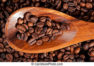 Coffee beans background - Coffee beans on wooden spoon on...